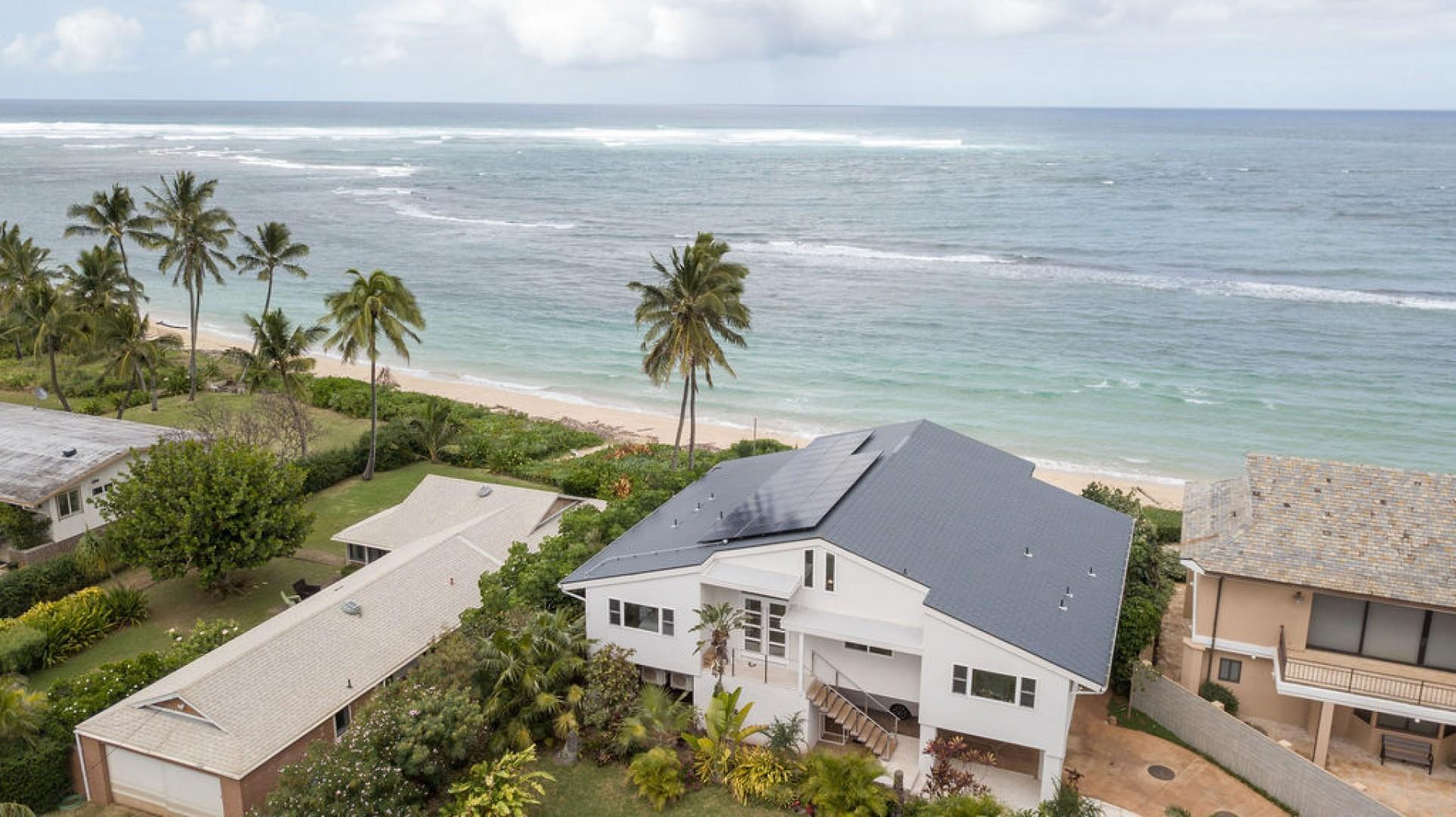 Aerial shot of property and the beautiful ocean