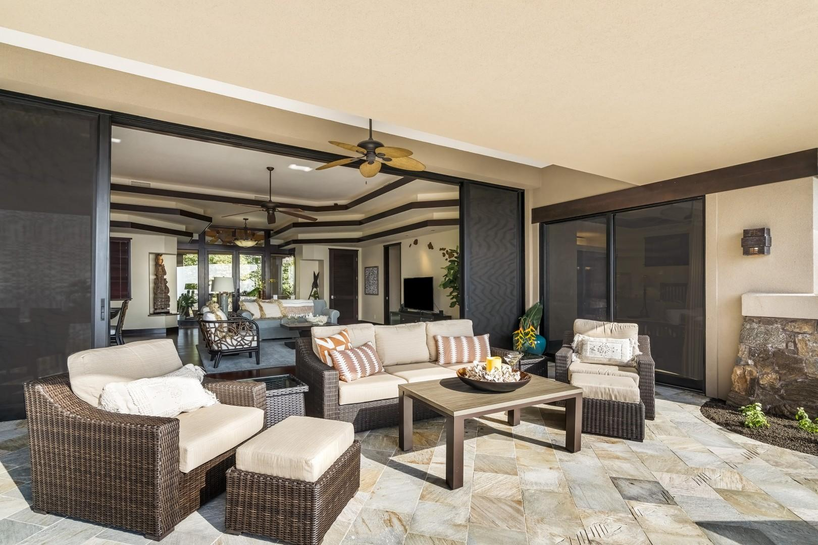 large sliding doors embrace Hawaii style living by connecting the outdoors to the inside