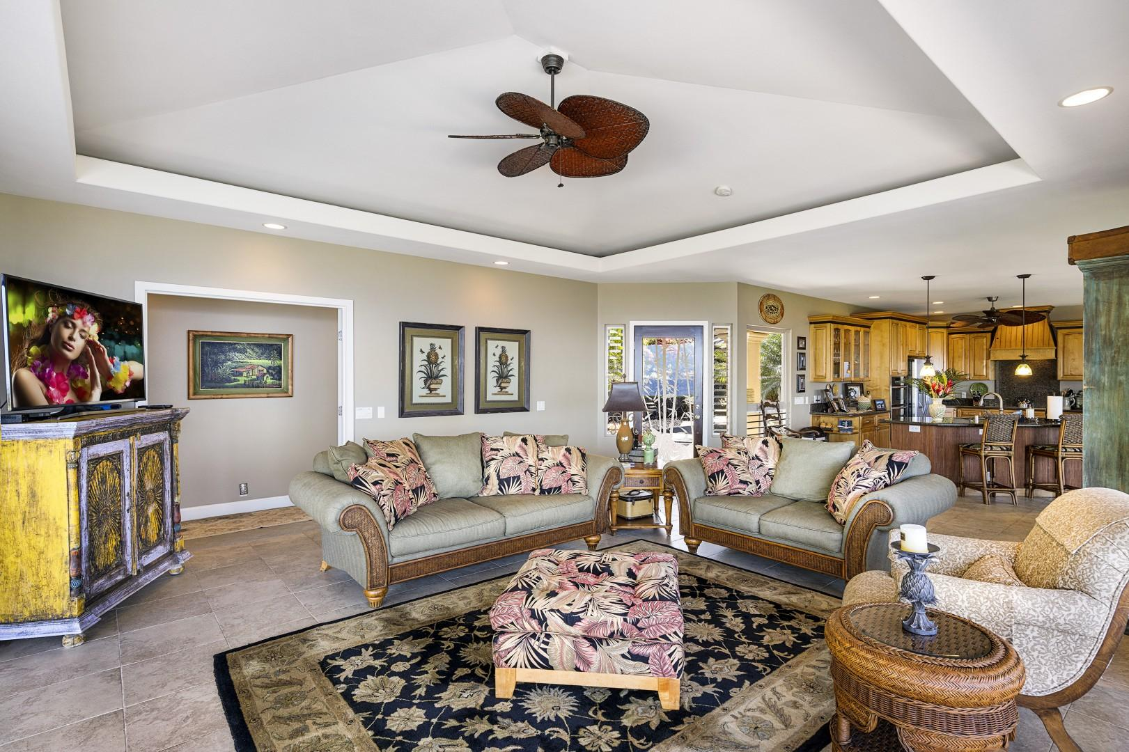 Tropically appointed living room with space for everyone!