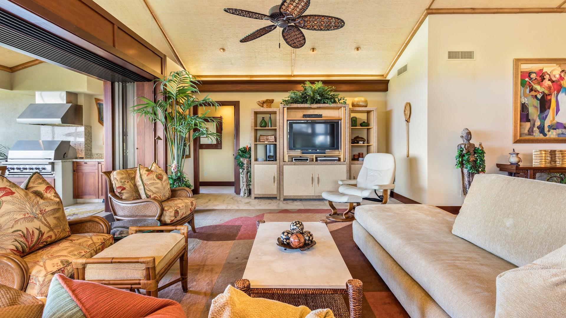 Side View of Living Area with Ample Seating & Flatscreen TV - Pocket Doors to Lanai for Indoor/Outdoor Living.