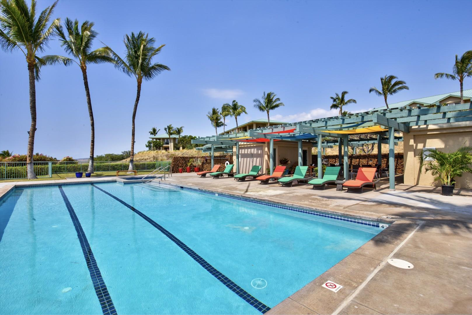 Kumulani amenities center with large lap pool, jacuzzi, loungers, BBQ grills, andcovered picnic area.