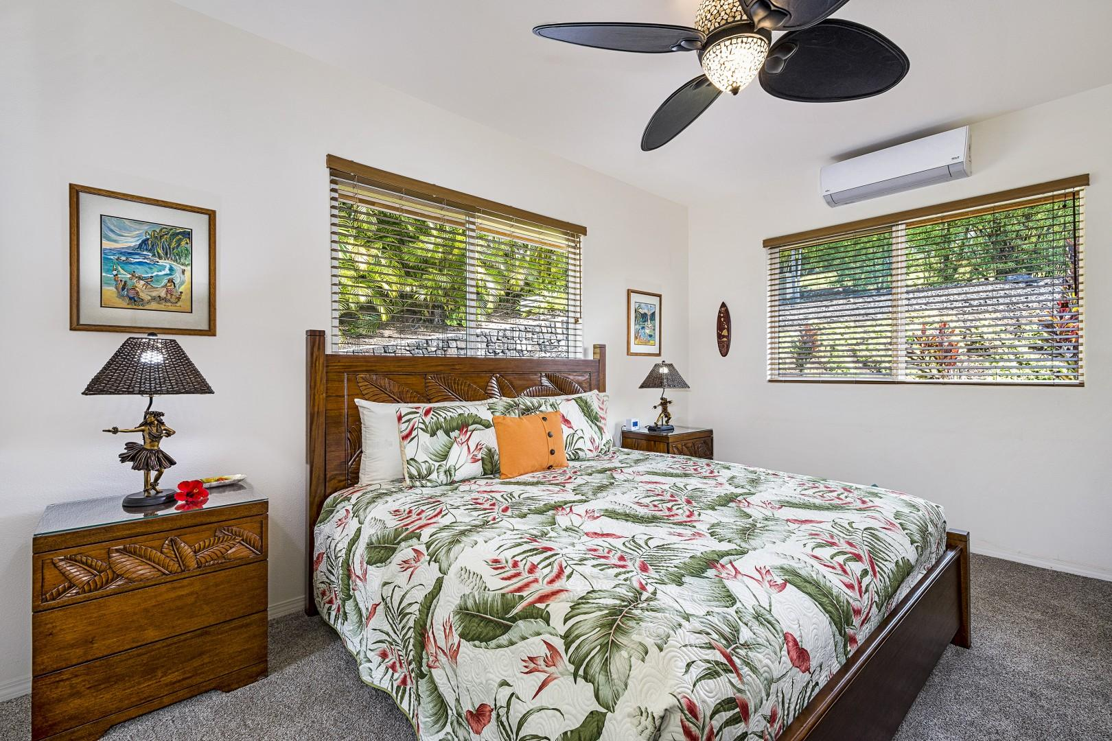 Guest bedroom with king bed, TV and A/C