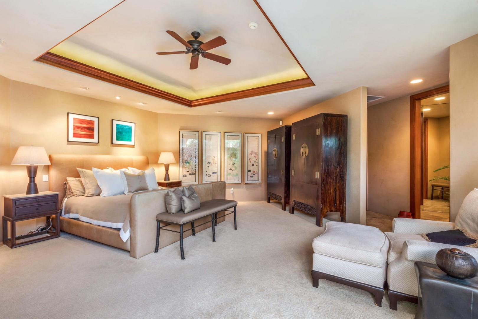Master bedroom suite with valance ceiling and seating area.