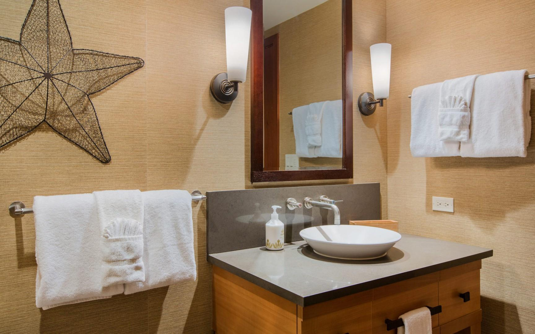 The 2nd (guest) bathroom features deep soaking tub and shower