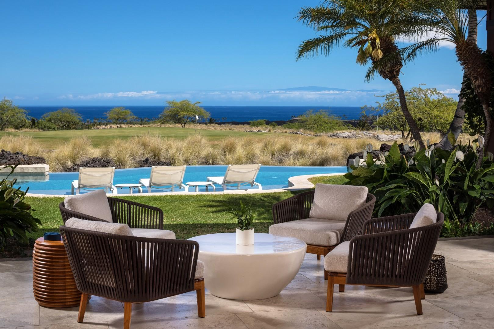 Multiple seating options on the lanai, all with ocean views.