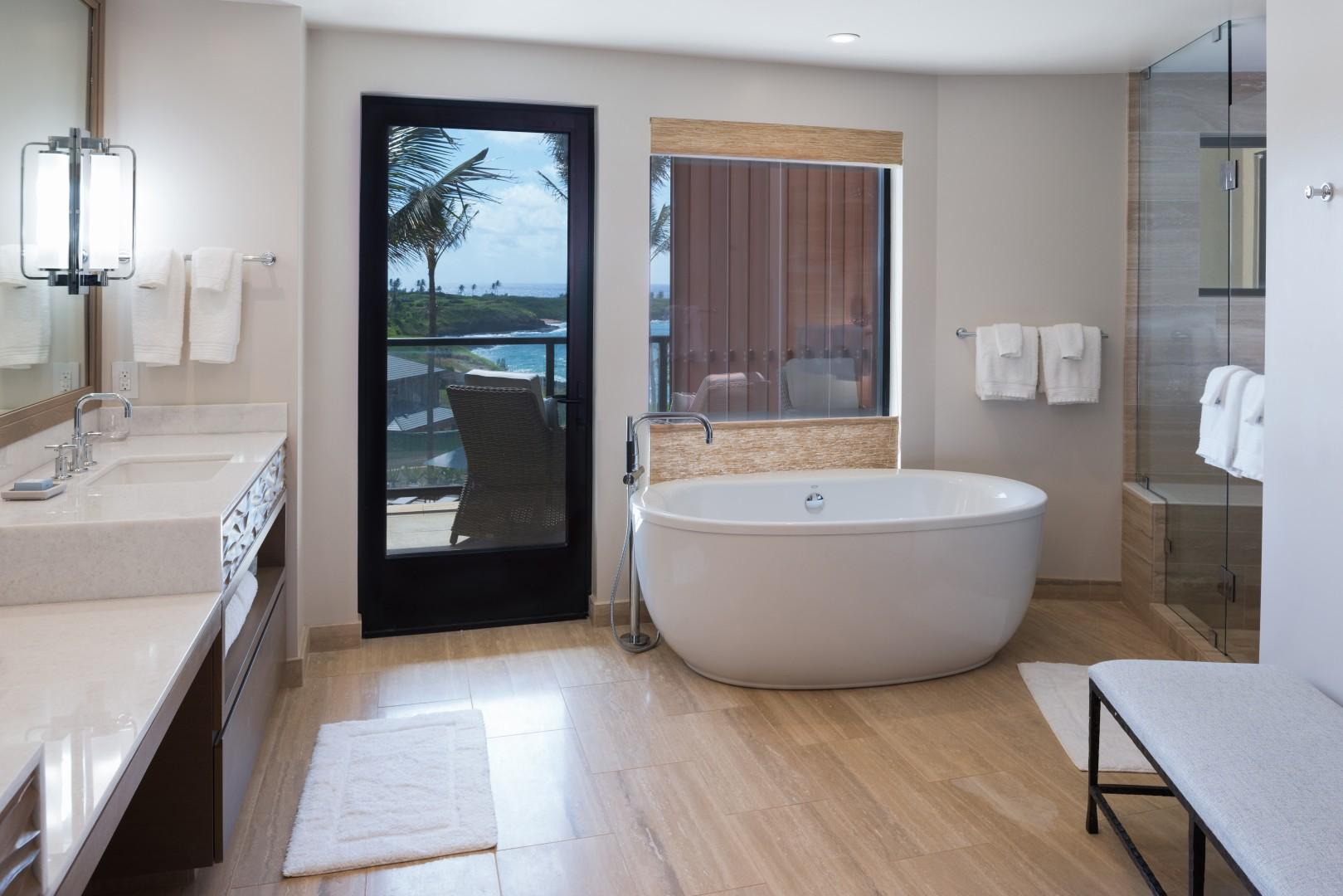 Each master bath boasts a soaking tub, a separate shower, and dual vanities.