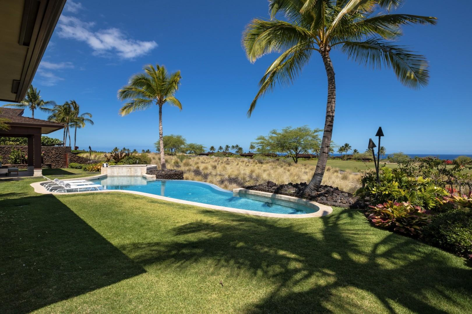 Alternate view of pool and grassy lawn, perfect for yard games and enjoying the tropical climate.