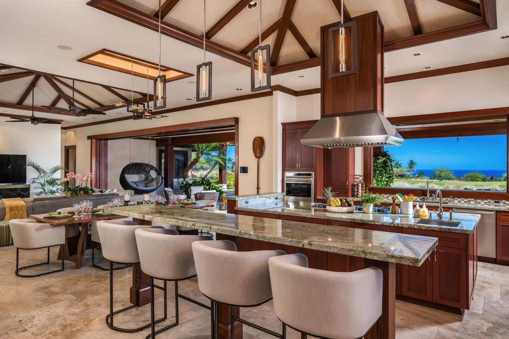 Bar seating for four facing kitchen, pool deck, and the ocean is perfect for conversation and flow during meal preparation.