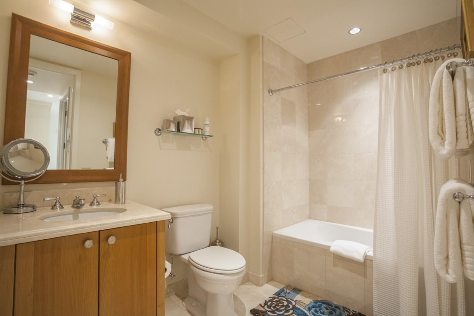 Third bedroom bath, with shower and tub.