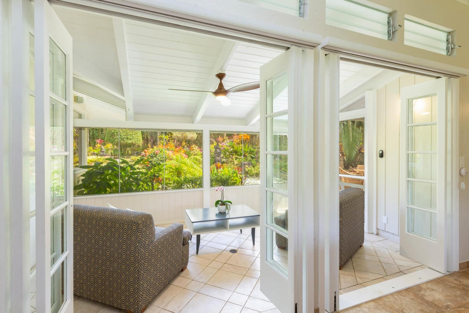 Screened lanai offers privacy and a cozy space to read, or enjoy a cup of Kona coffee