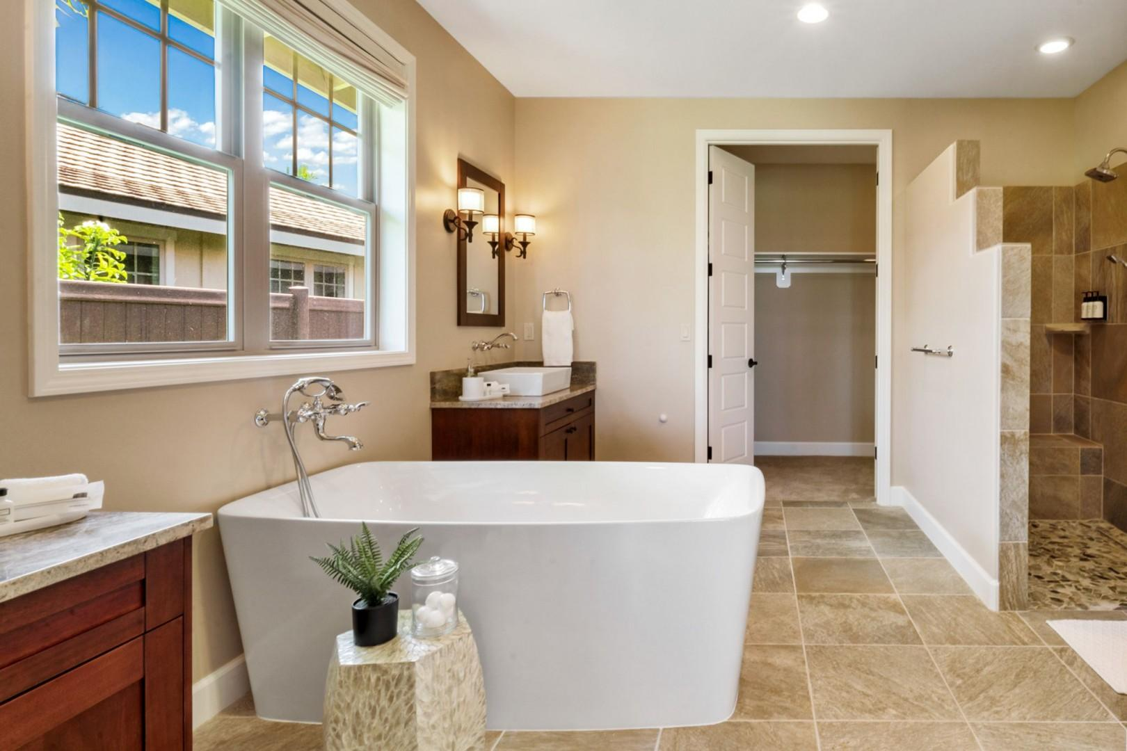 Ensuite equipped with dual vanities, soaking tub, walk in shower and closet