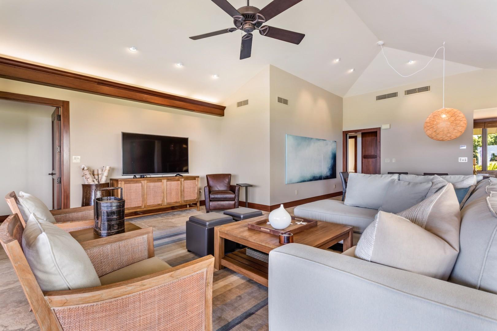 Vaulted ceilings and recessed lighting in the spacious living area.
