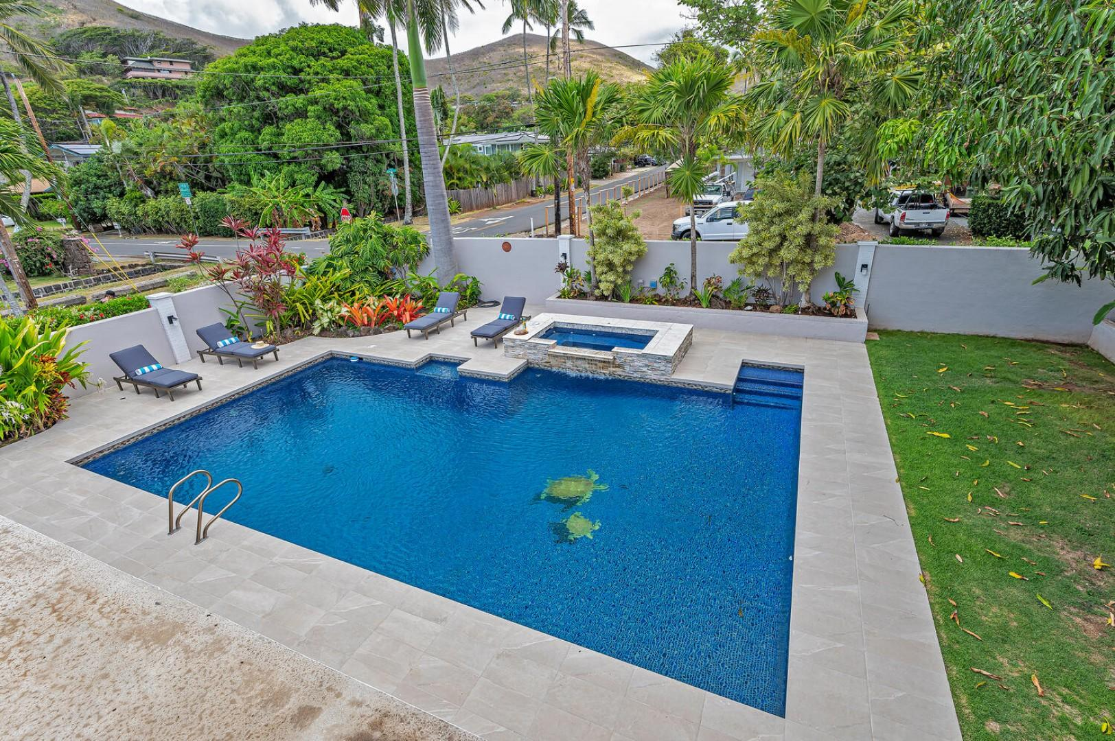 Birds eye view of the pool from the media room lanai. (Note: Upper pool area is apart of the pool and NOT a spa)