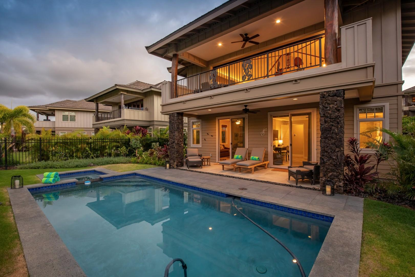 Pool and home at twilight.
