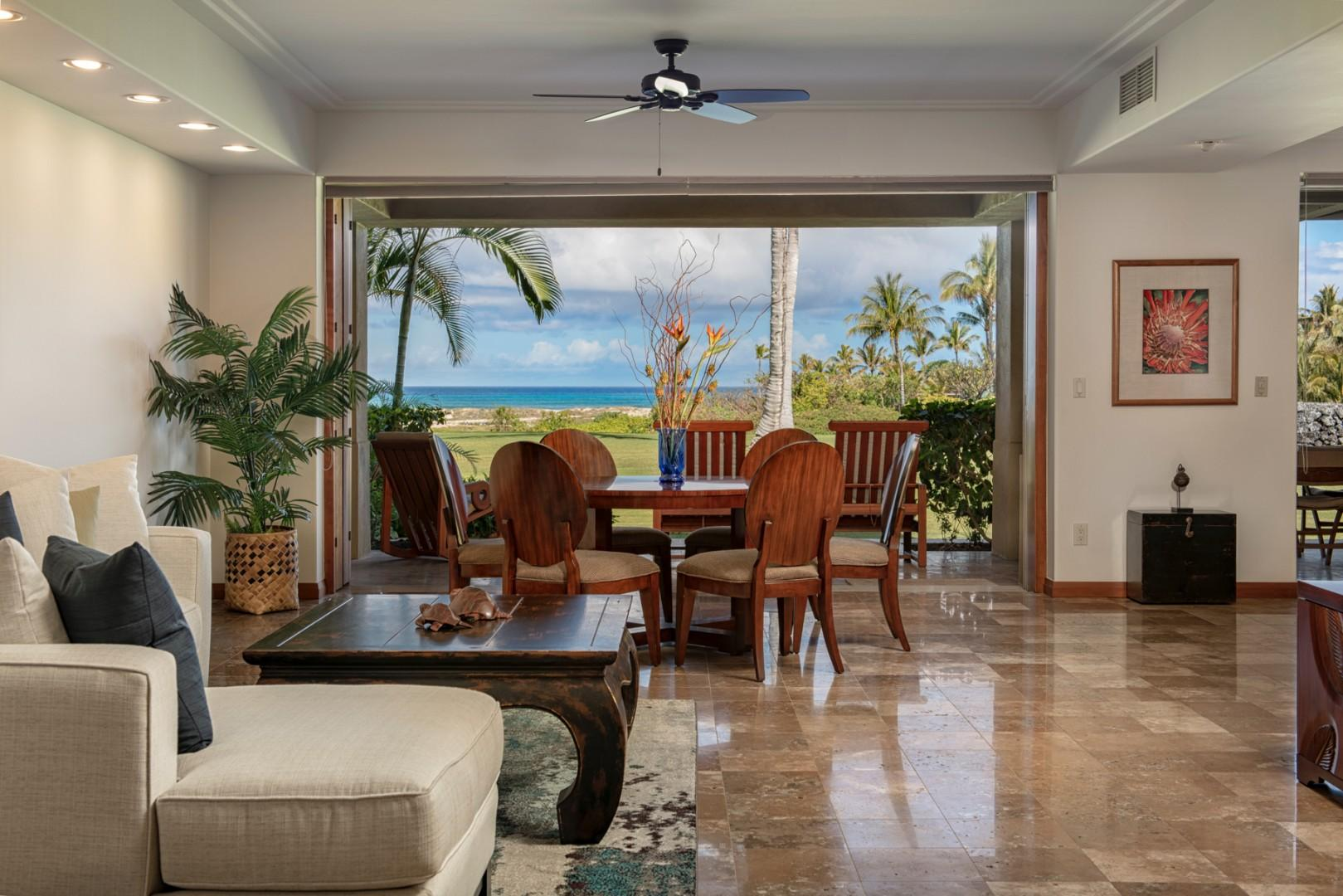 Multiple seating areas in great room with recessed ceilings and gorgeous natural light.