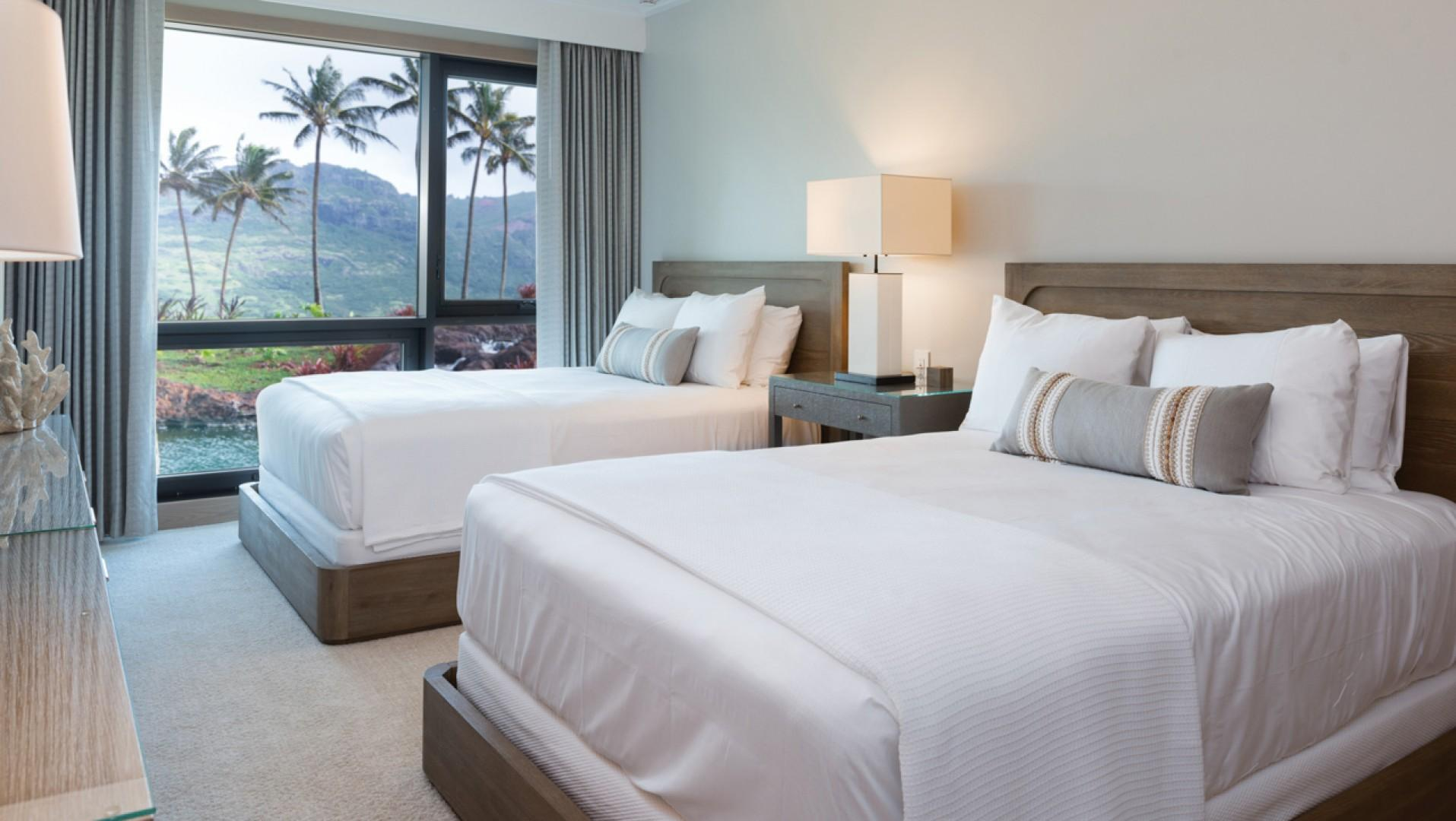 The third bedroom features two queen-size beds.