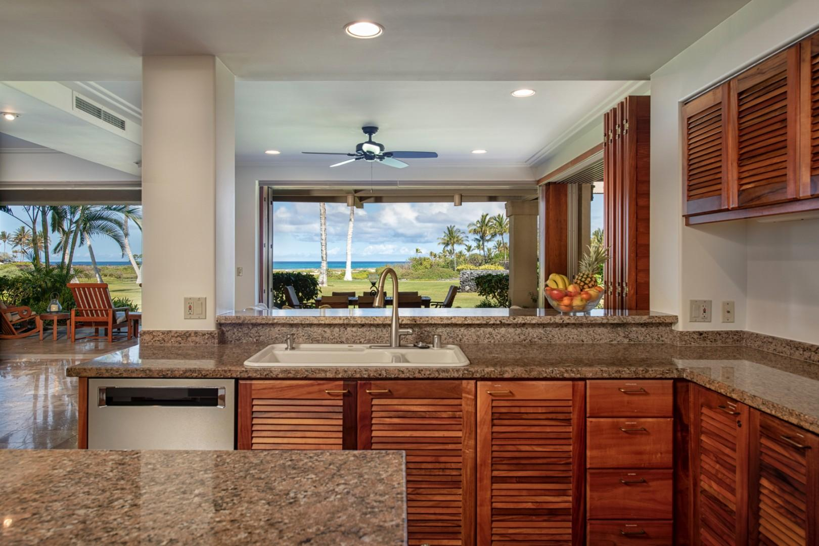 Alternate view of kitchen highlighting ocean view.