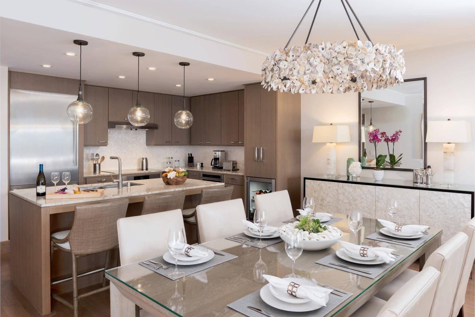 The residences feature formal dining spaces as well as bar seating in sleek, well-equipped kitchens.