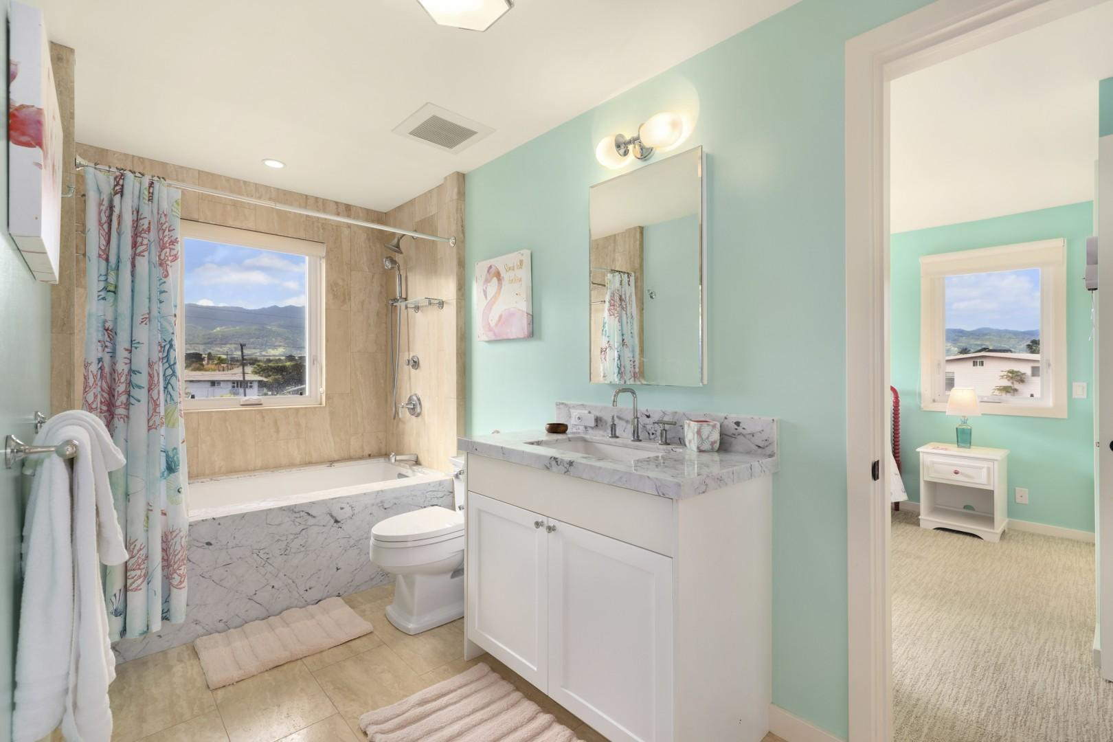 Jack-and-Jill bathroom with mountain views and whirlpool tub.