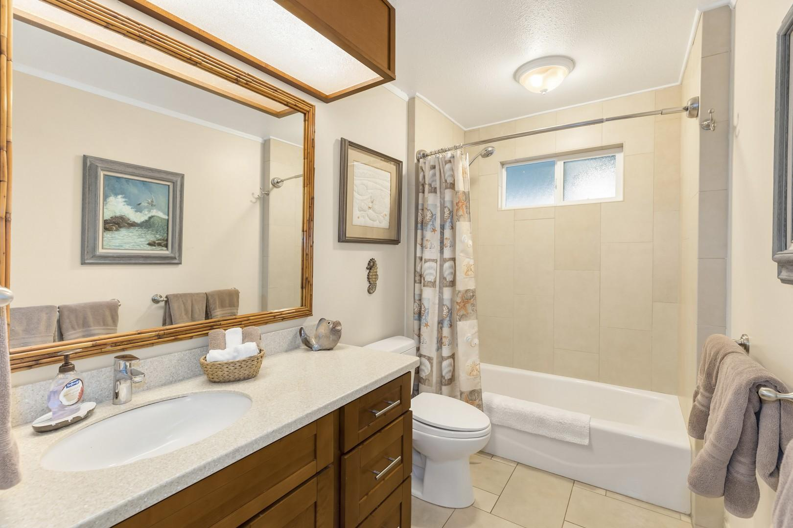 Guest bath upstairs with tub.