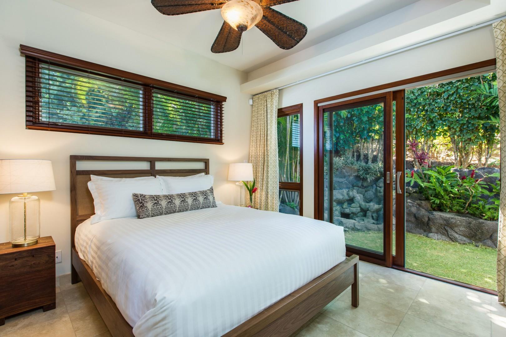 Second floor queen bedroom with sliding door to the back yard.