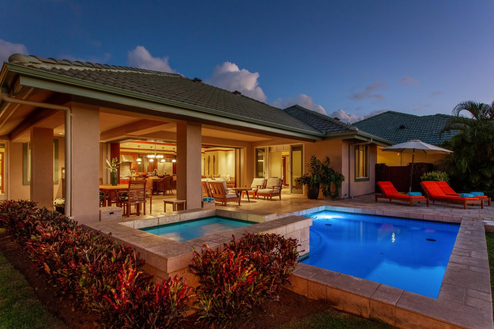 Alternate view of home at twilight showcasing the indoor-outdoor living.