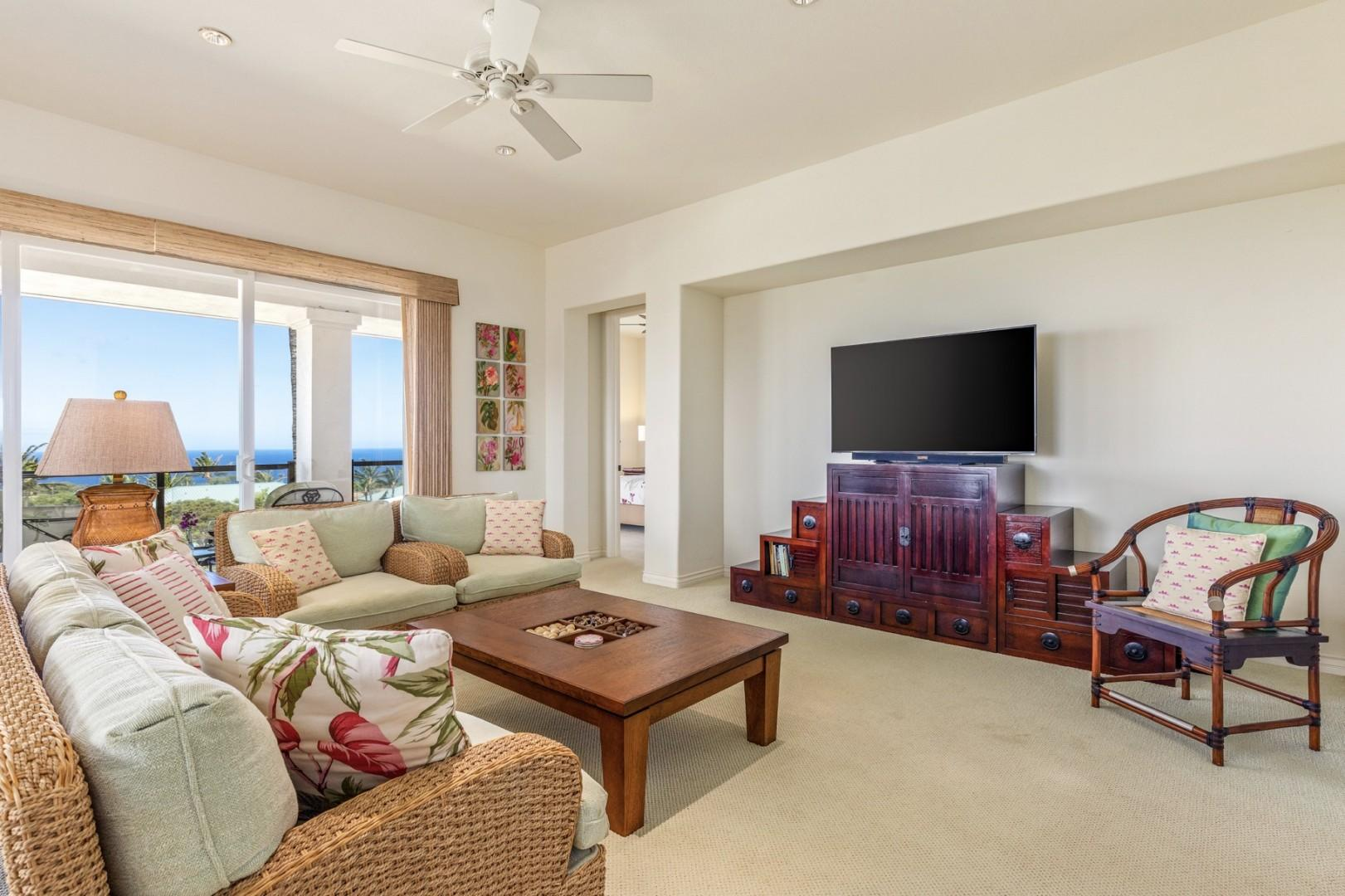 Spacious ocean view living area with lanai access and flat screen TV.