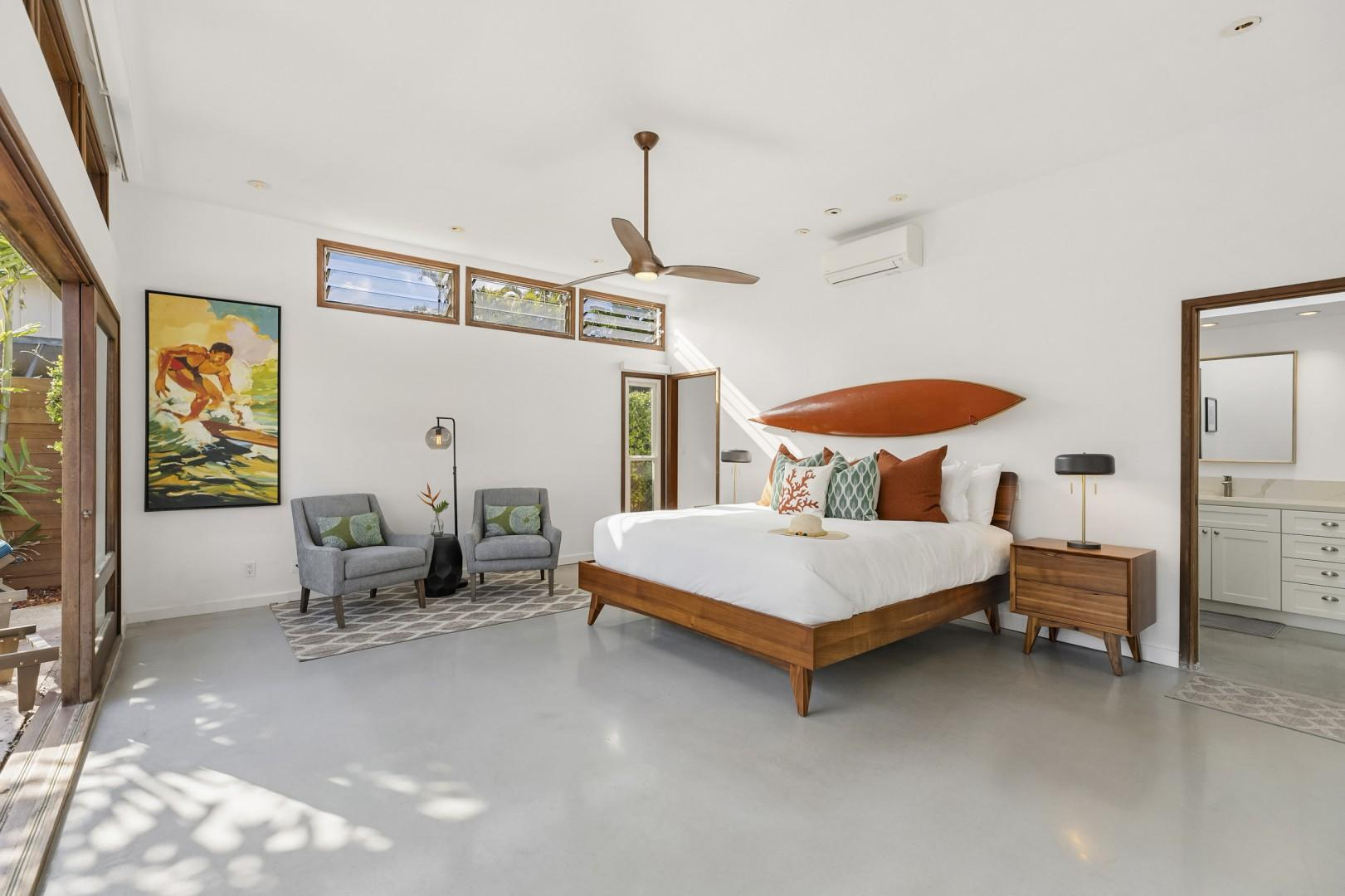 Master bedroom with walk in closet and en suite and pool views!
