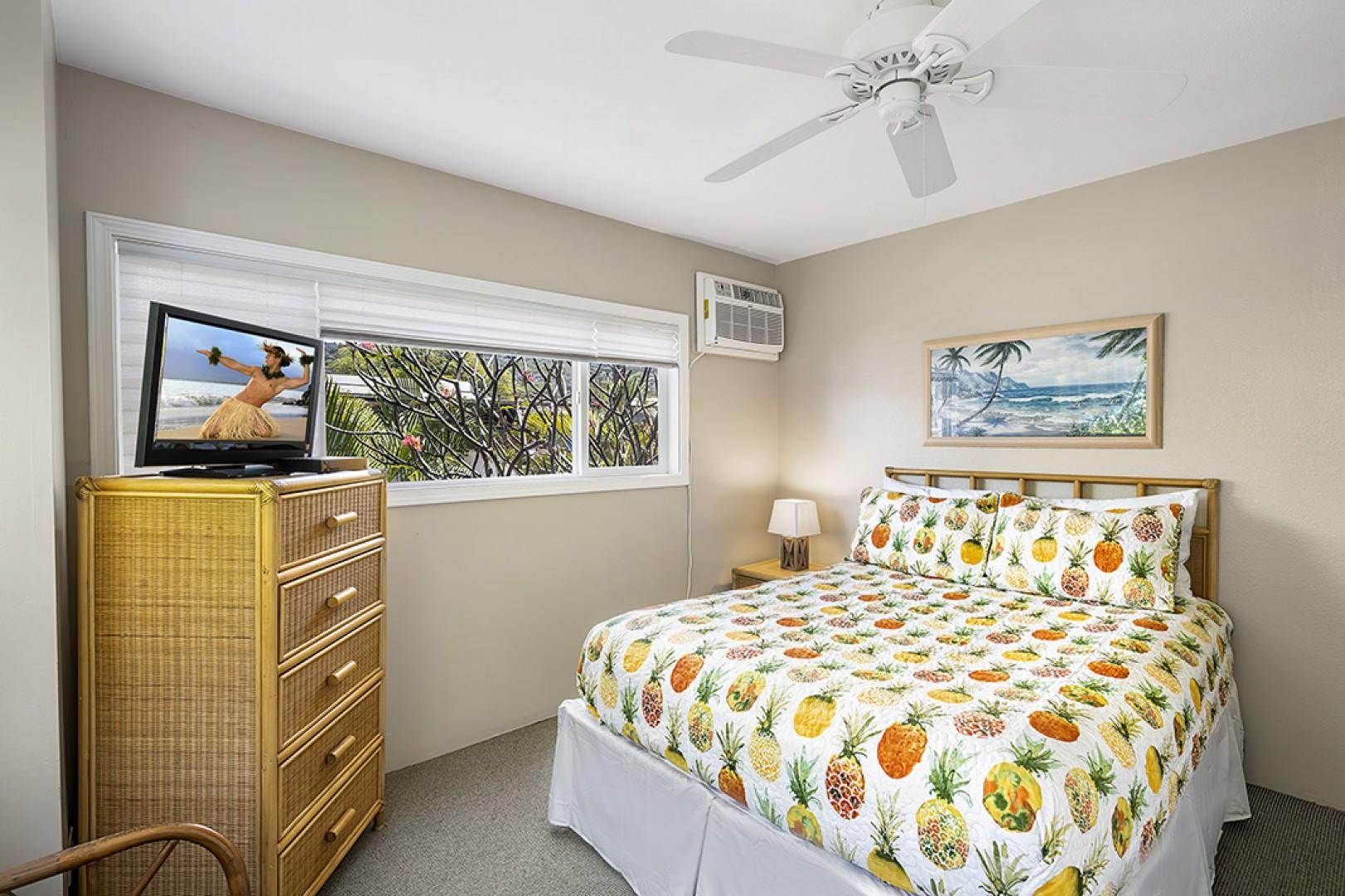 Guest bedroom featuring a Queen bed and wall unit A/C