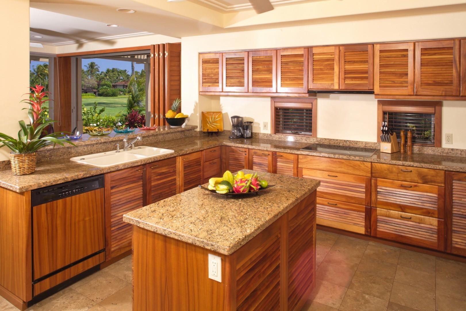 Elegant gourmet modern kitchen w/granite countertops and top tier appliances.