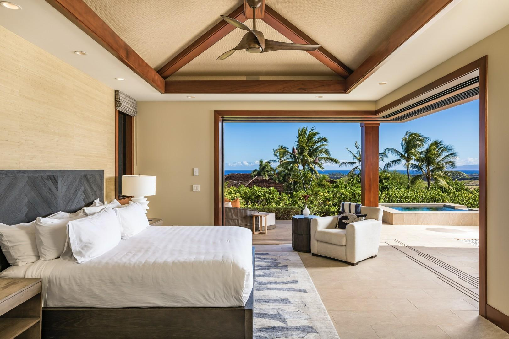 Master suite expands onto the lanai via two walls of pocket doors, showcasing ocean, pool deck and mountain vistas.