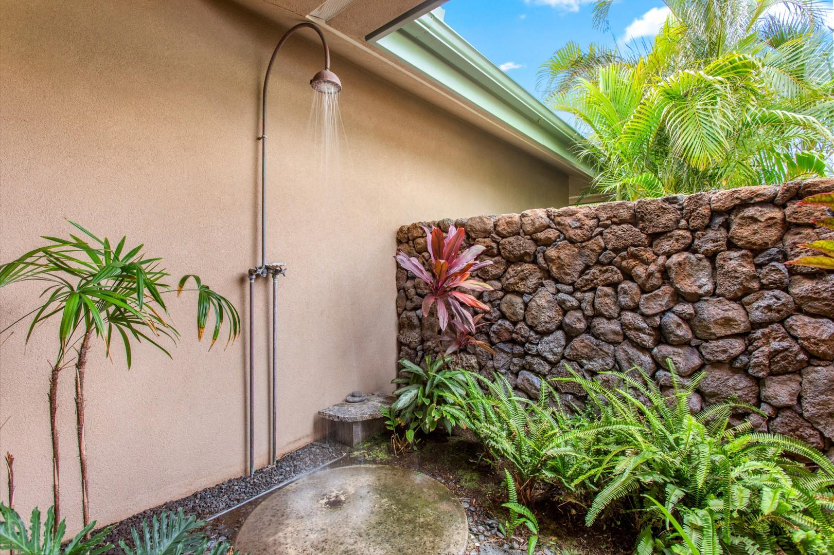 Closer view of the outdoor shower garden with tropical landscaping.