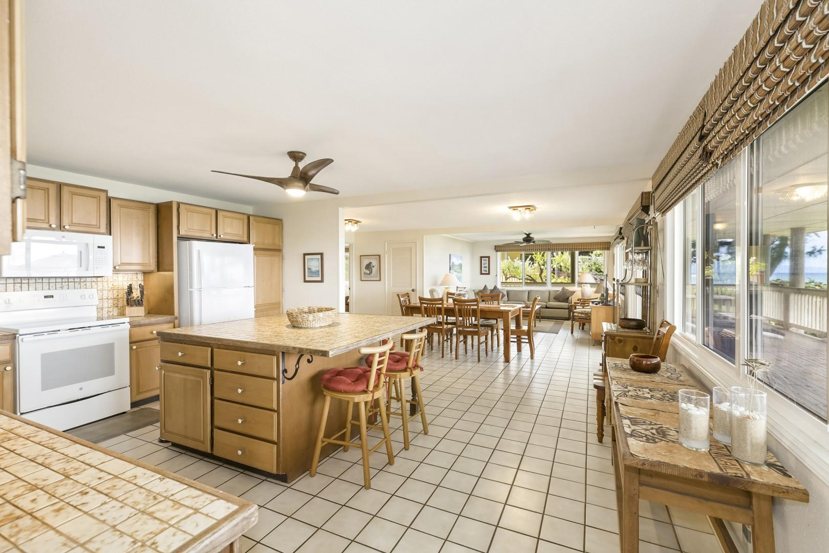 Large kitchen with tile floors, great for cooking family meals together.