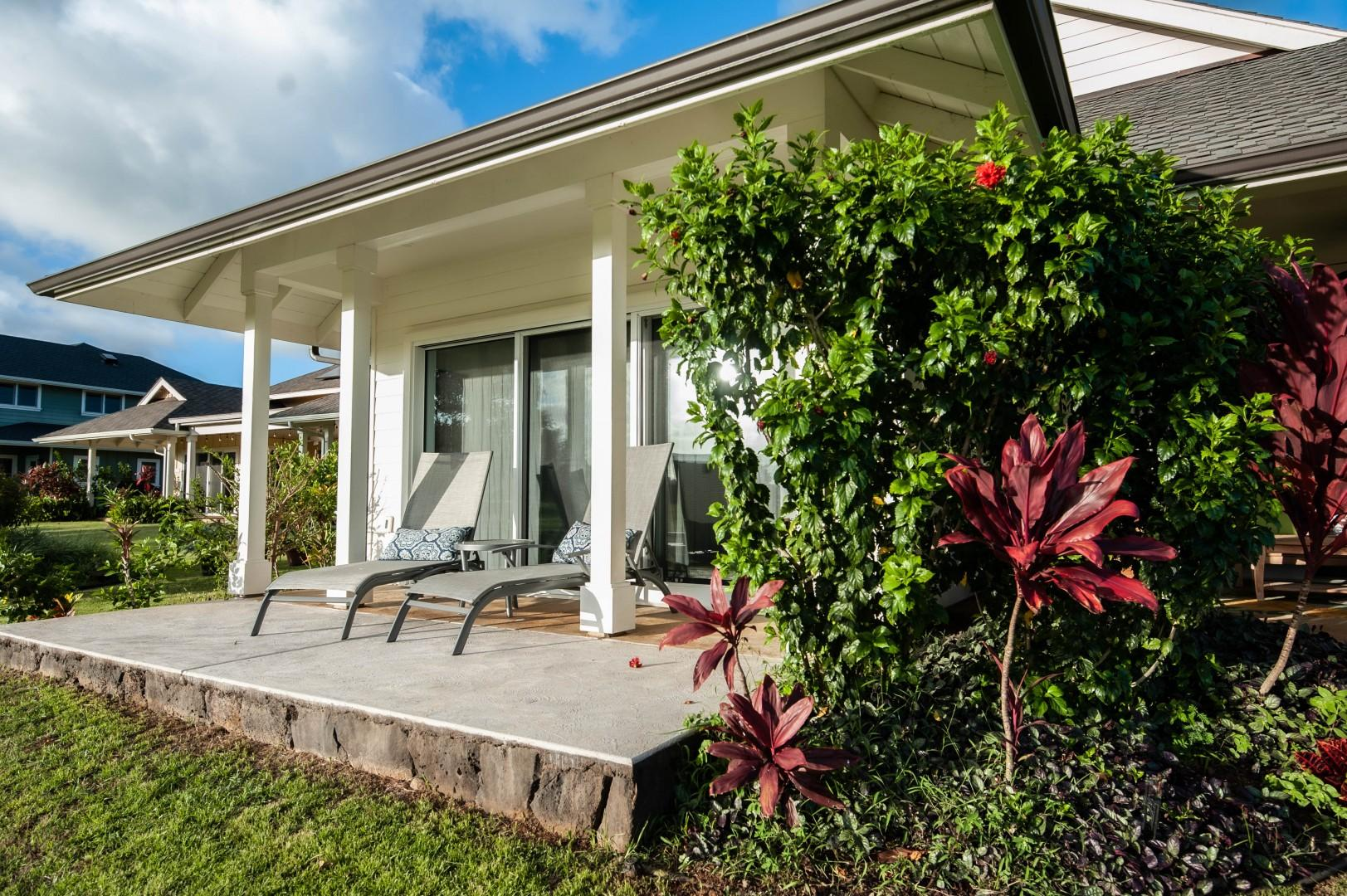 Master Bedroom Lanai with lounge chairs and golf course and sunset views
