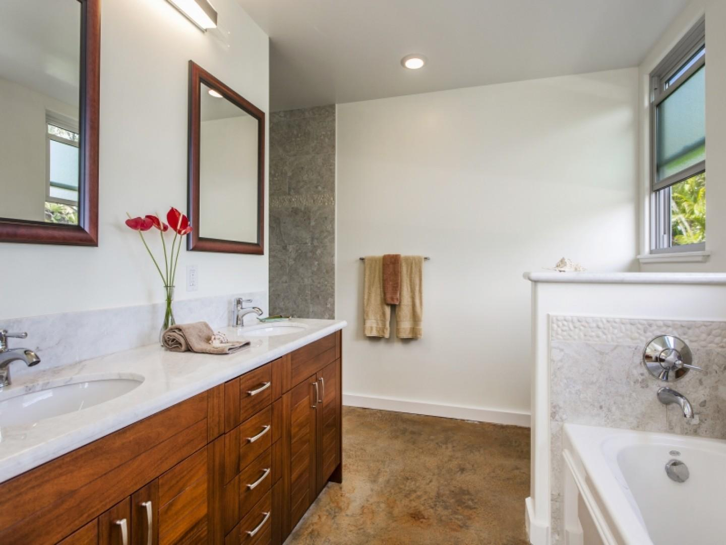 First-floor master bath with tub and walk-in shower.