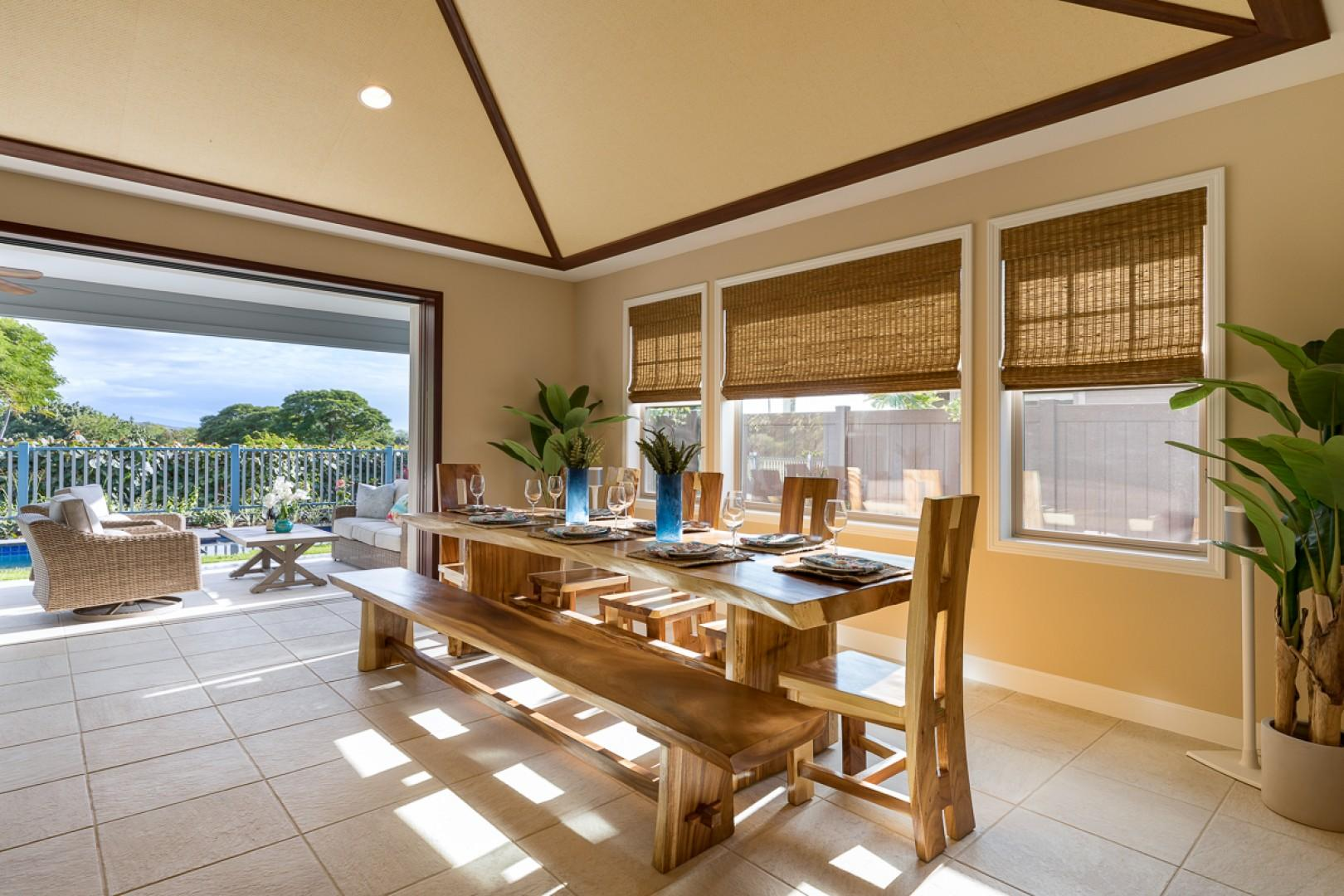 The spacious dining room, with the lanai beyond