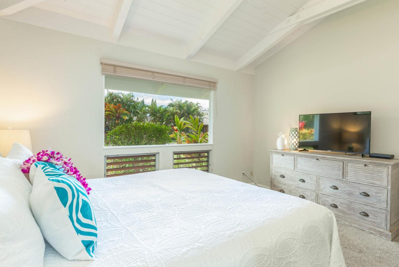 Enjoy watching the view and the TV from the comfort of your bed