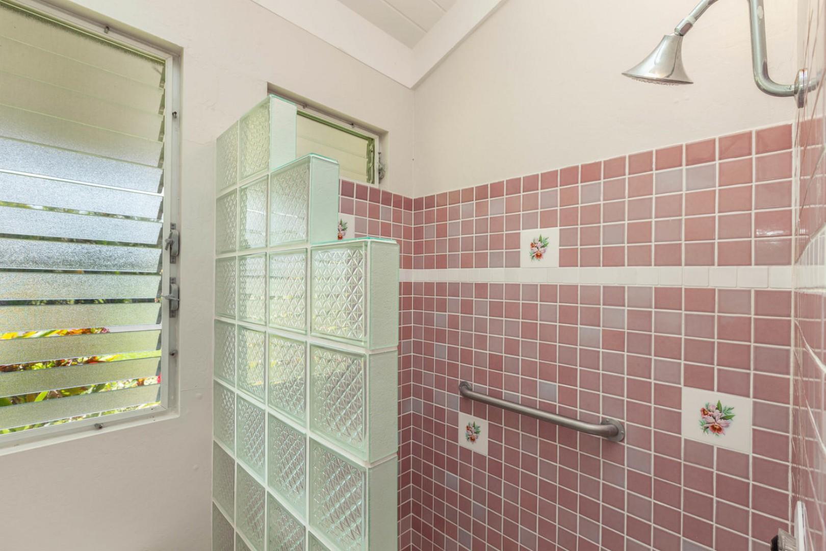 Tiled shower in shared bathroom