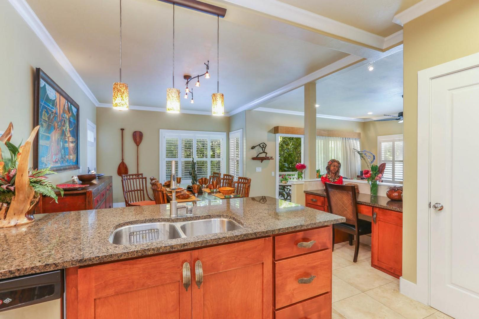 Open kitchen leading into dining area