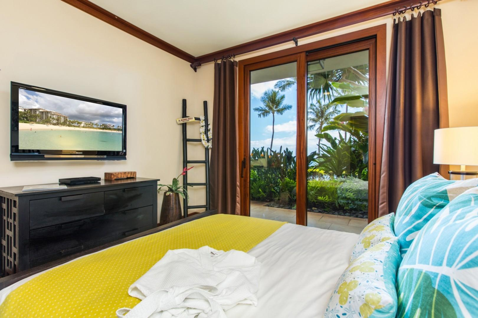 The 2nd (guest) bedroom with two twin beds which can be converted into a king features flat screen wall-mounted TV, BluRay DVD player, ceiling fan and lanai access (New photos featuring new beds coming soon)