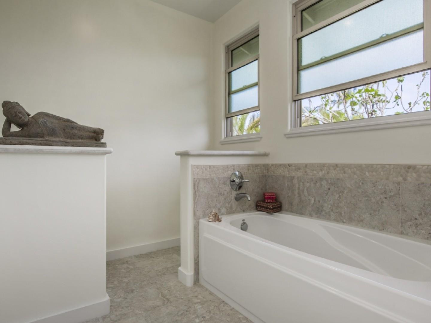 Master bath with deep tub for relaxing.