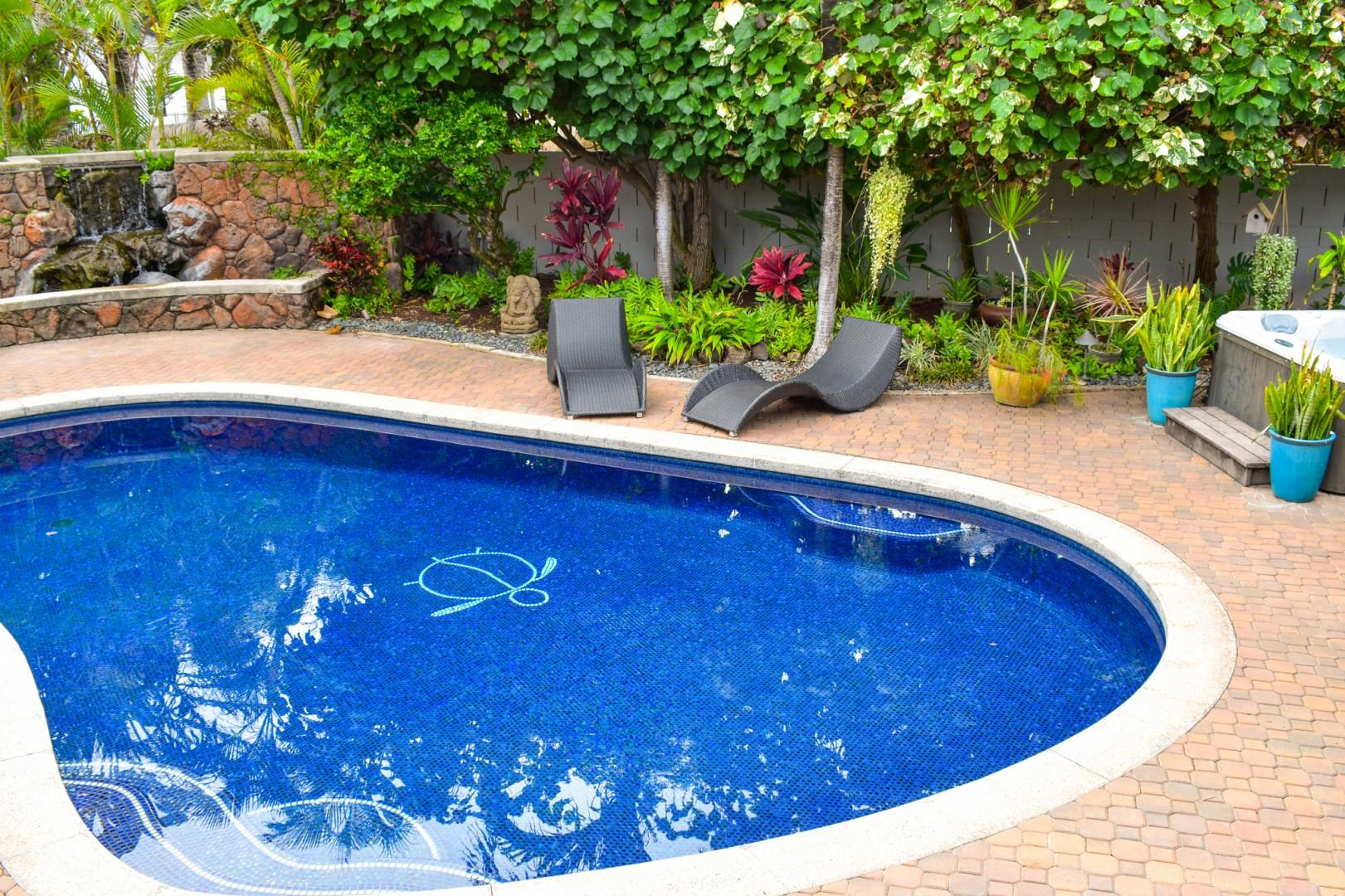 Tranquil pool area with a Jacuzzi and waterfall!