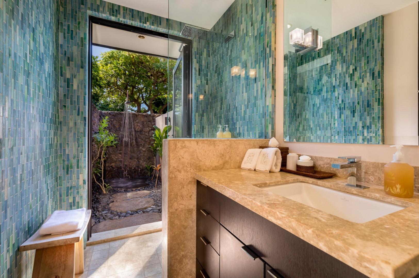 Another luxurious bath with an outdoor shower garden