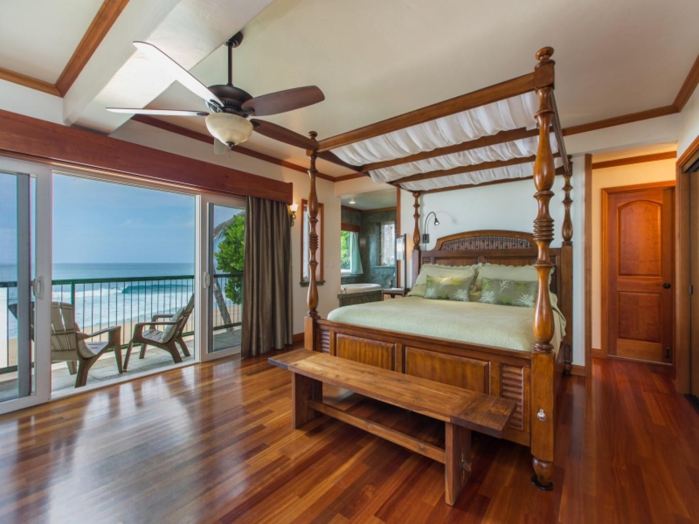 Master suite with king-size canopy bed and spectacular ocean views.