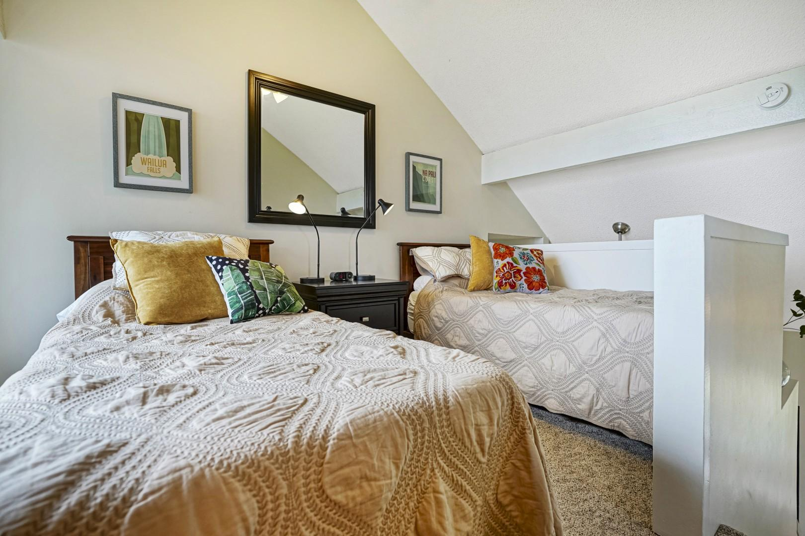 The loft-style second bedroom