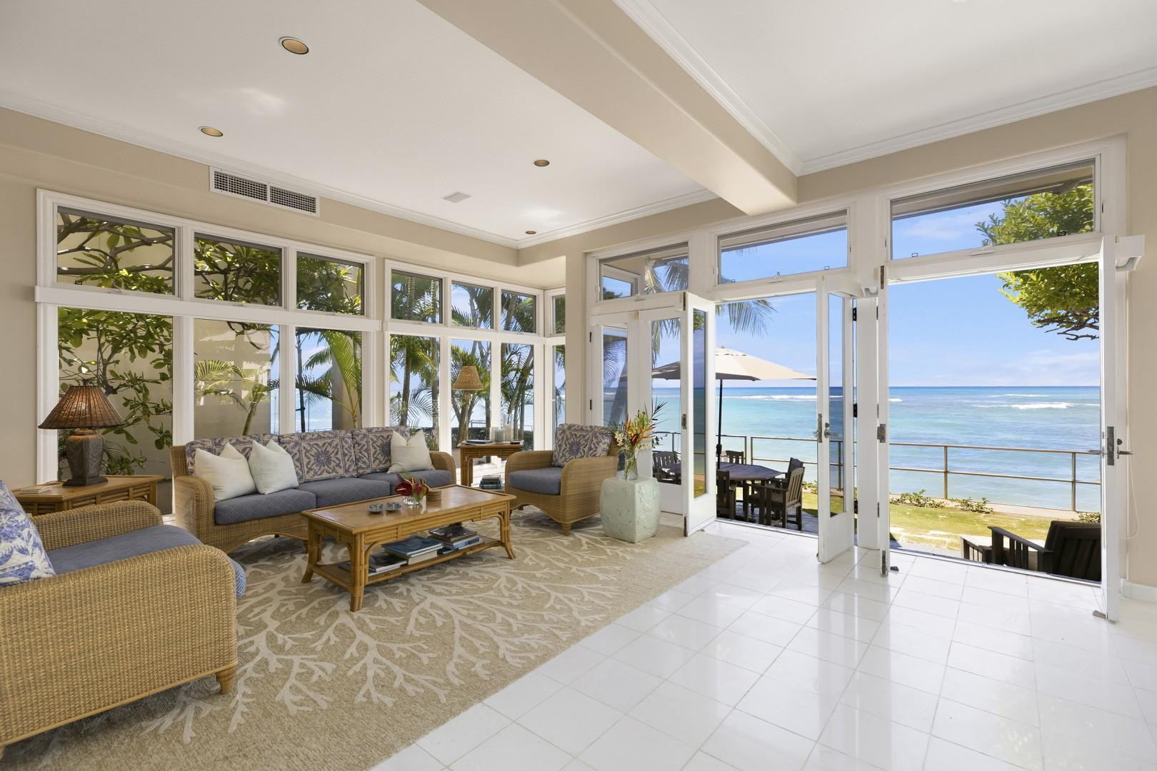 Living Room opens up to the Oceanside Lanai and Yard.