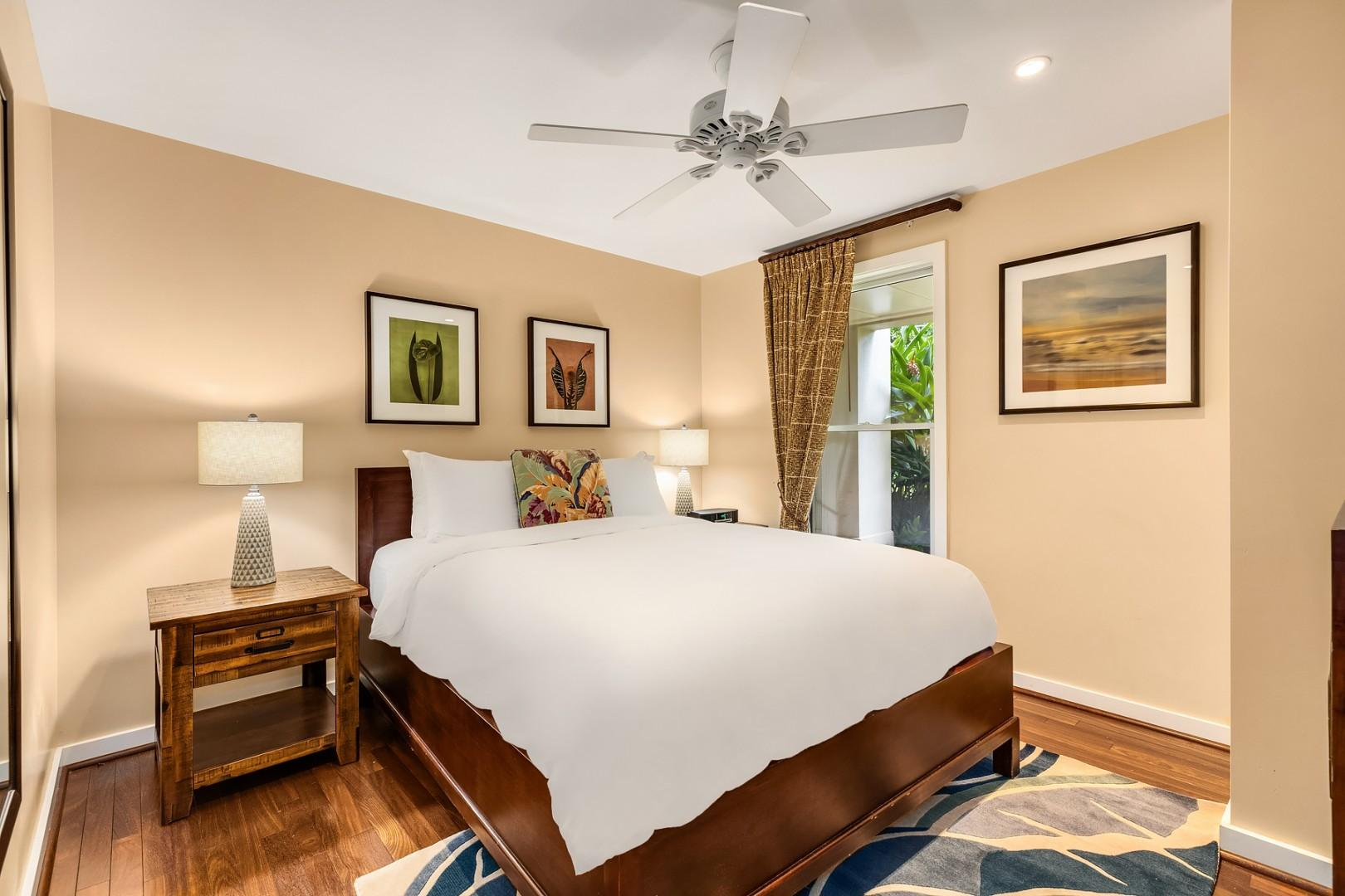 Guest bedroom with queen sized bed and upgraded furnishings.