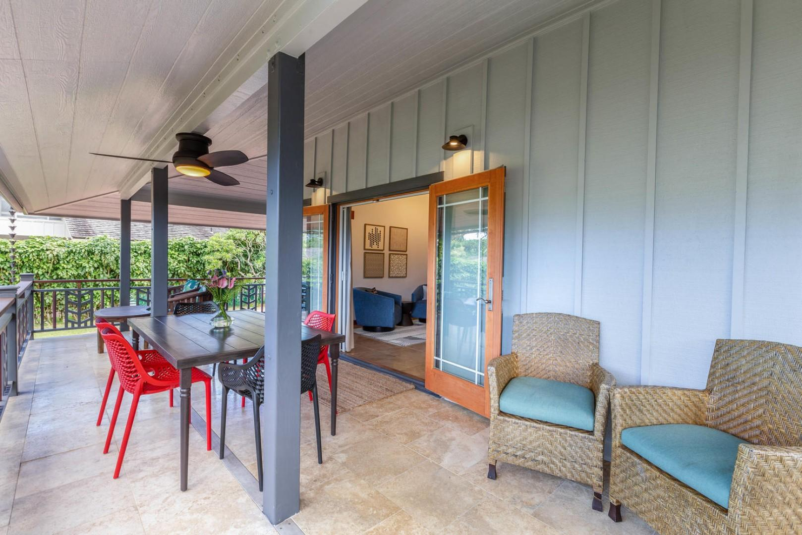 Covered lanai with places to dine and relax