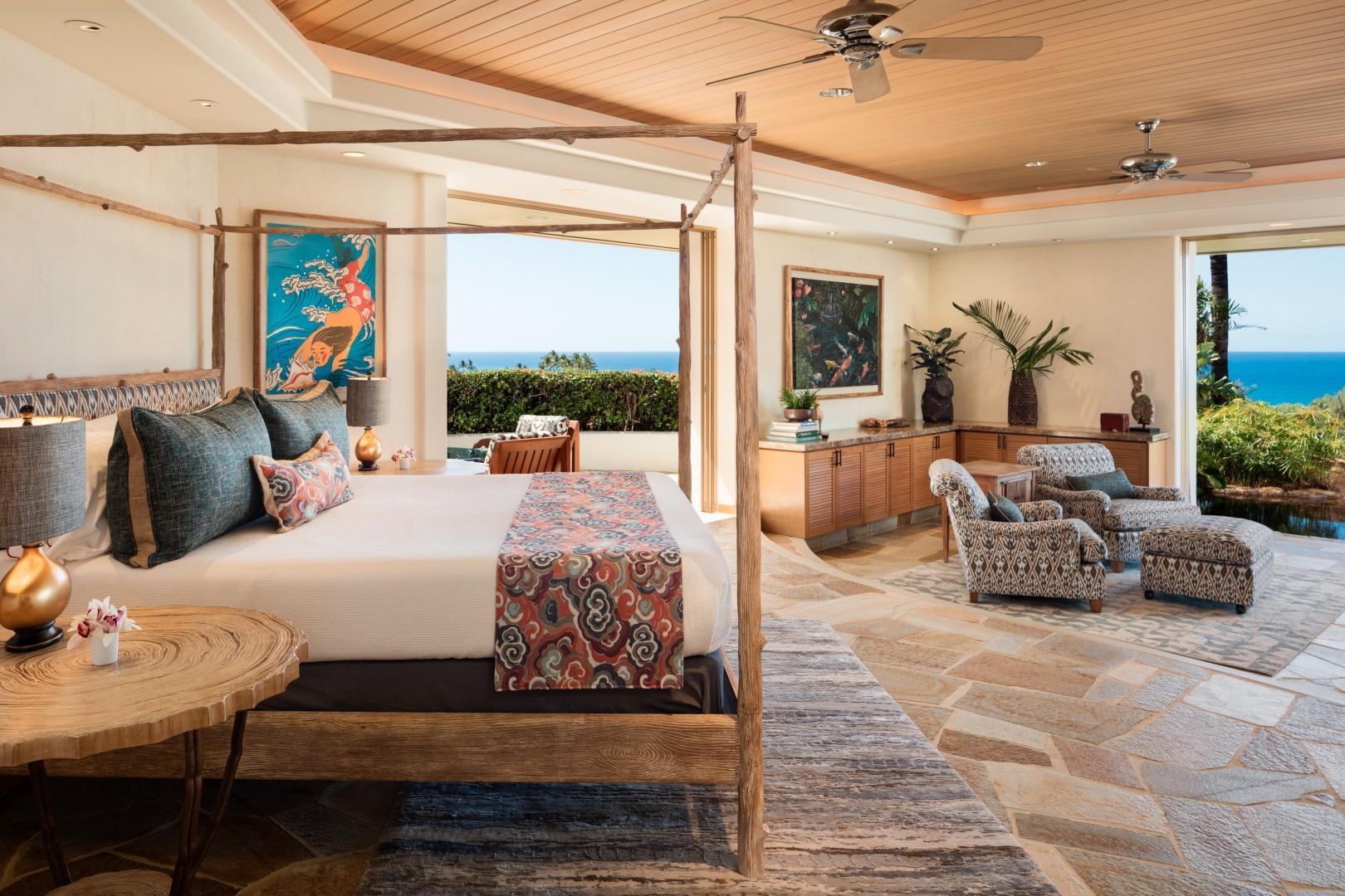 Ocean-view master suite with flat-screen TV, private deck with seating, and sitting area with view over waterfall.