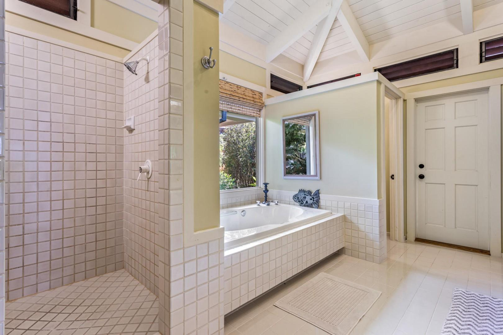 The master bath has a deep tub and a separate shower.